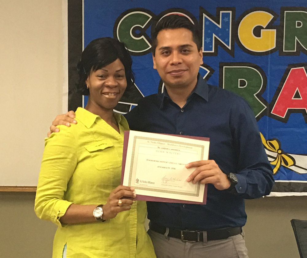 CDL graduate Dian Walters receives her certificate of completion from Nestor Zelarayan, Skills Training career coach.