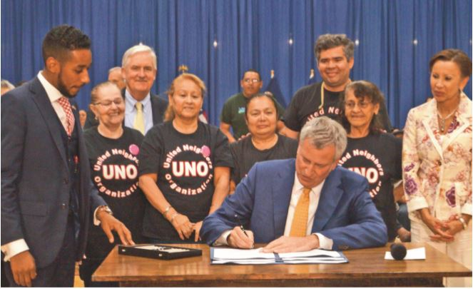 Mayor De Blasio signs Stand for Tenant Safety legislation, which was named after the grassroots coalition in which, St. Nicks Alliance played a critical role. This legislation will help protect tenants from landlord harassment used to get them out of their homes