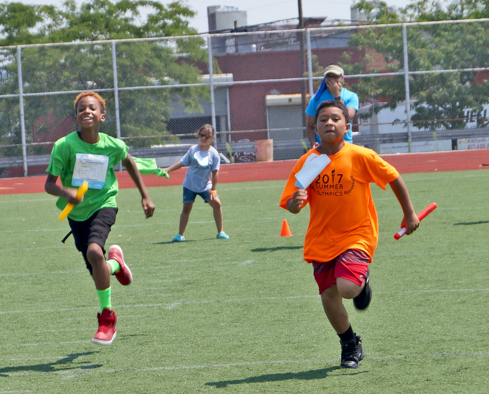 St. Nicks Alliance's afterschool youth are quick on their feet and learn teamwork as they participate in a relay race during the annual Summer Olympics!