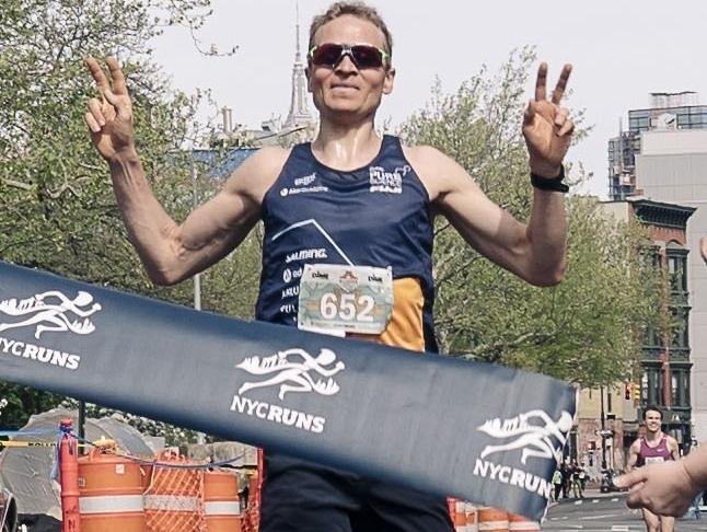 Overall winner of the 2018 Dime McCarren 5K, Trond Atle Smedsrud, crosses the finish line