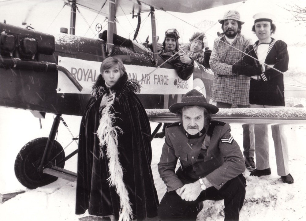An early Air Farce promotional still: Luba Goy and Dave in the foreground; Don Ferguson, John Morgan, Martin Bronstein, and Roger Abbott in the background - 1974