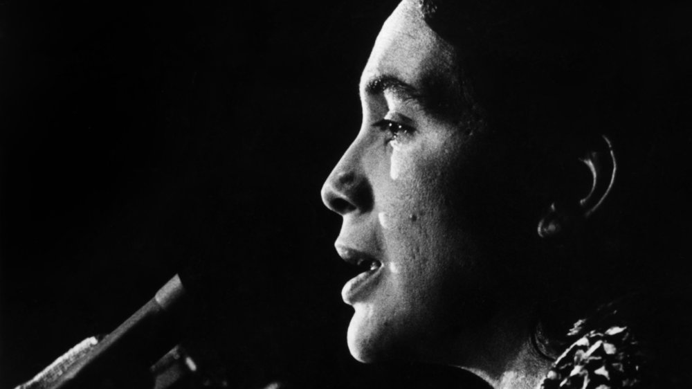#4 - Dolores Huerta speaks at the podium. c1970s. Courtesy of Walter P. Reuther Library Archives of Labor and Urban Affairs Wayne State University.jpg