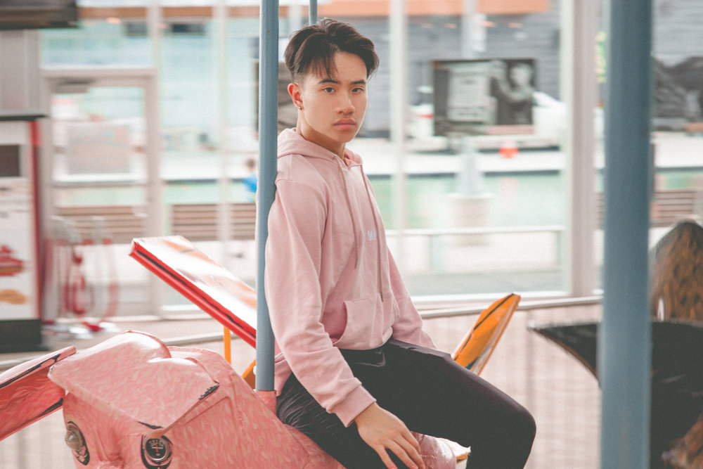 "Koven Wei wearing a ""You and I"" hoodie in pink"