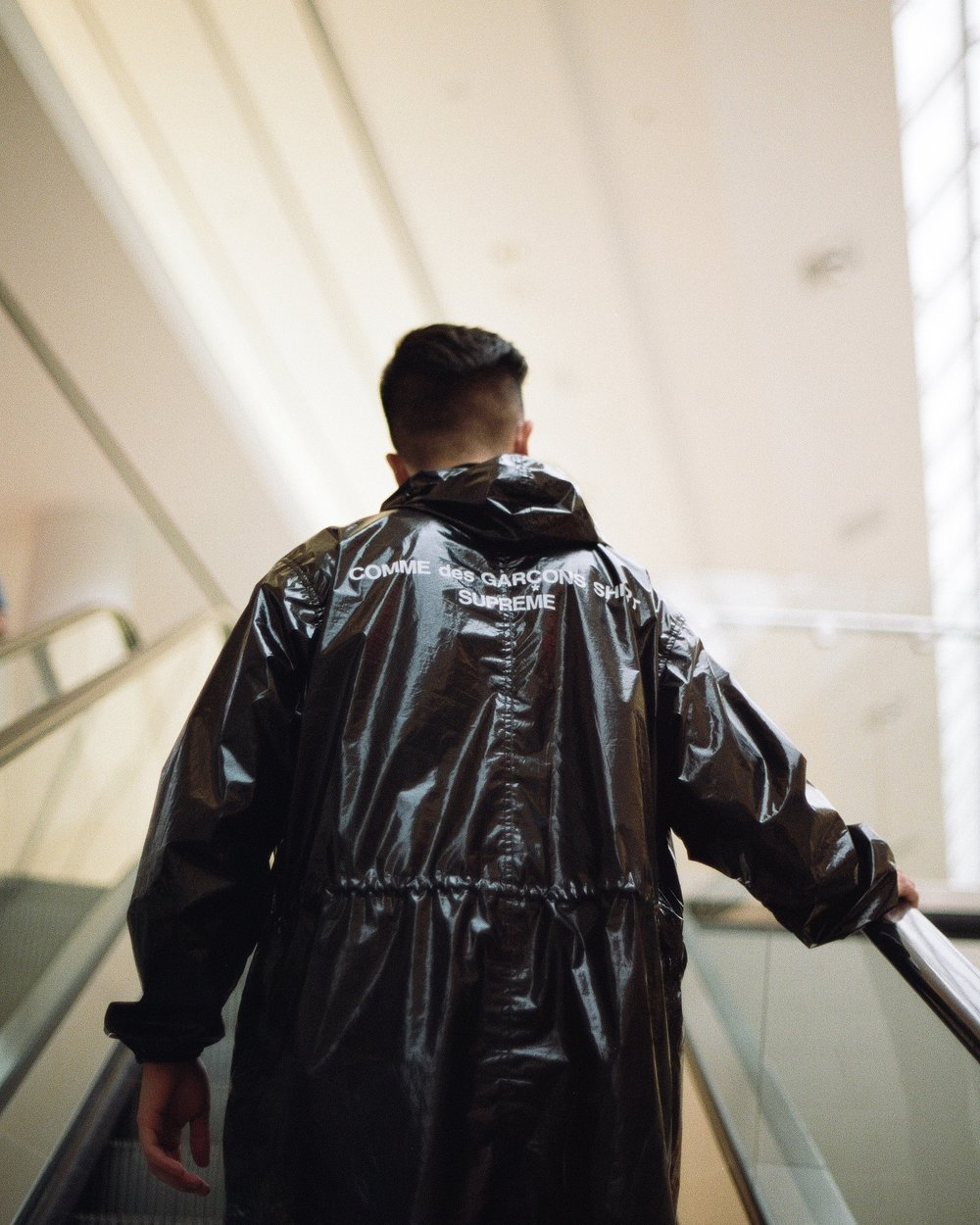 Koven Wei rocking a Comme Des Garcons and Supreme Fishtail Raincoat