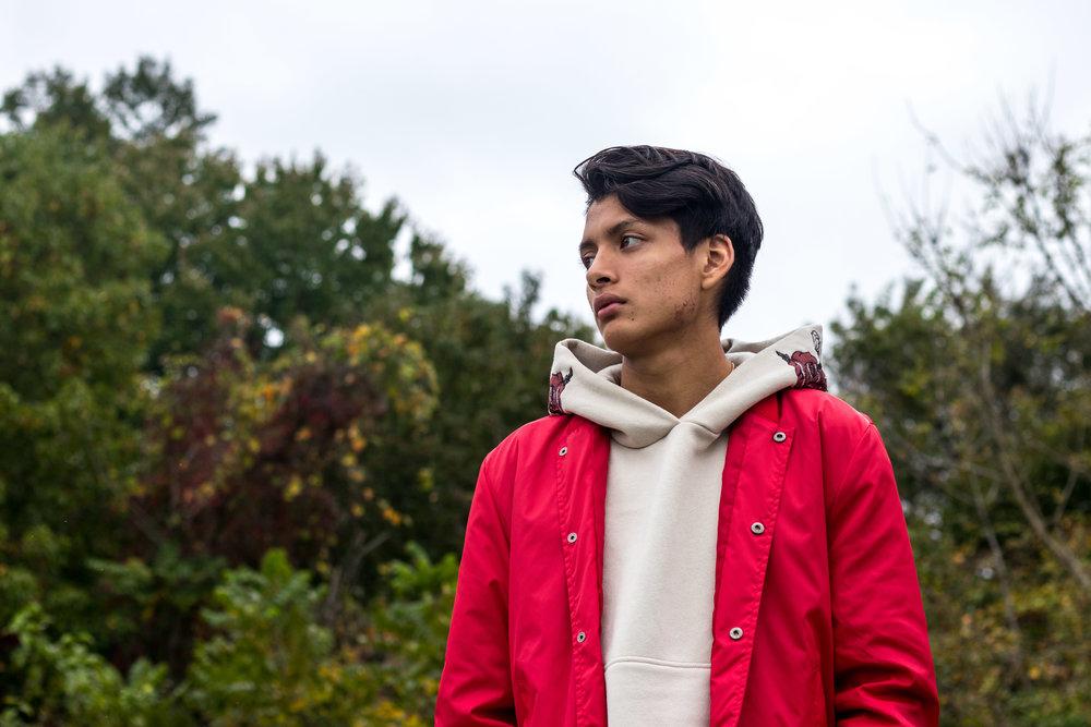 Charlie Serrano wears a Red and Black Varsity Jacket