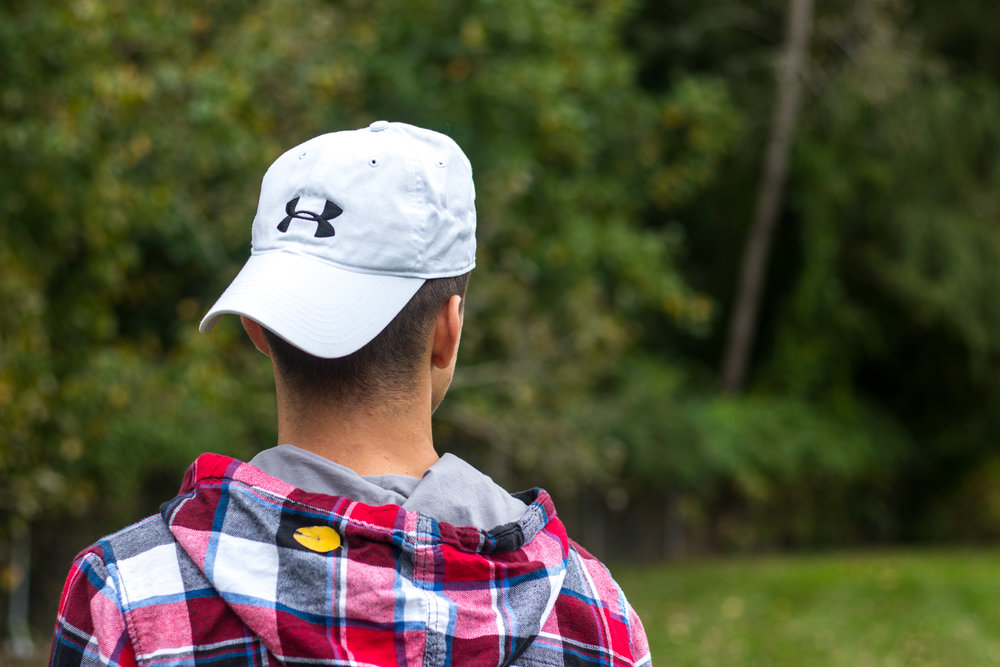 Dane Papalia wears a white Under Armour hat