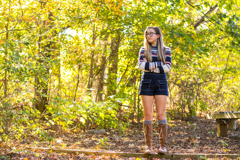 Brielle Surdez wearing women's brown knee high lace up boots
