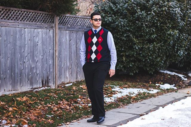 """Breaking the Boundaries of Friendship + Timeless Argyle Sweater Vest Vibes: Change is difficult. Change is scary. But sometimes, it's for the better in ways not expected. Jason Nunez, wearing some classic and timeless men's fashion, shares his experiences with his best friend during childhood, Gabe, who had to move away from America. Jason remembers when he first met Gabe when they were five, just as Jason's family settled in Cliffwood Beach. By coincidence, Jason just happen to meet Gabe at the local waterfront, and after playing a round of catch, Jason saw that they both had passions for sports like baseball and football. Their parents exchanged numbers, and keeping in touch was easy, only being a few miles away."" Continue reading at pauloparadox.com (Link in bio). . . . . . . . #mensfashionblog #mensfashionpost #dapperday #dapperstyle #sweaters #argyle #sweatervest #portraitphotography #tiedup #winterstyle #snowday #dressed"