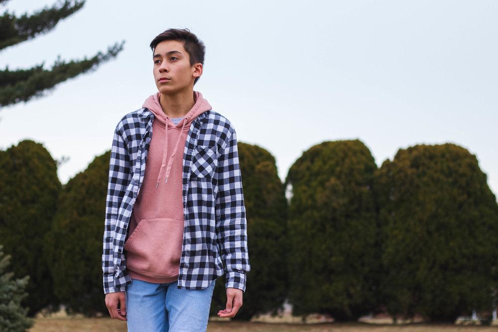 Marco Medel wearing a salmon pink hoodie