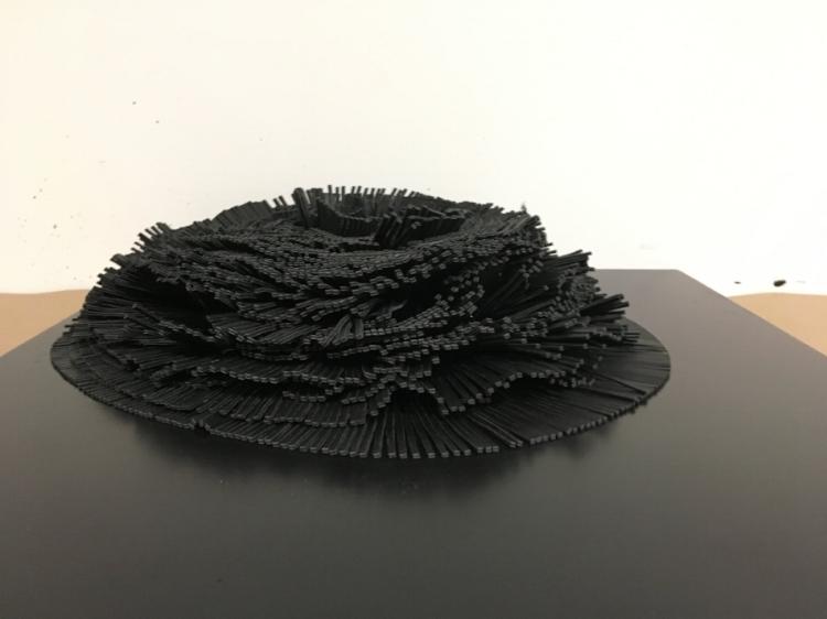 "Fringe Element, 2018. Leather fringe sculpture, 18"" x 18"" x 5"""