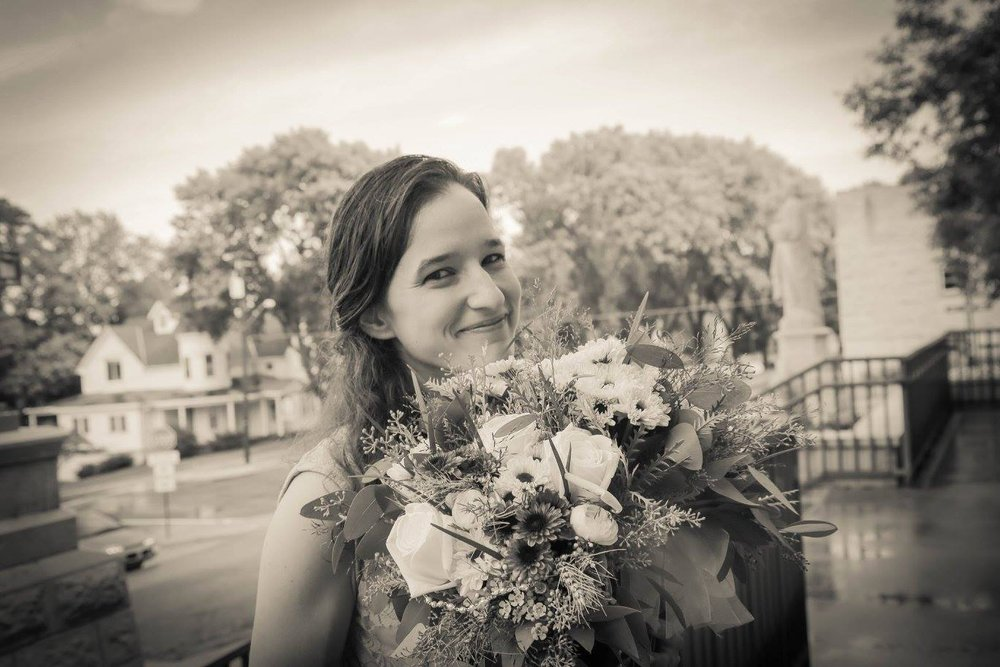 Holding the bride's bouquet for a wedding in Mankato, MN.