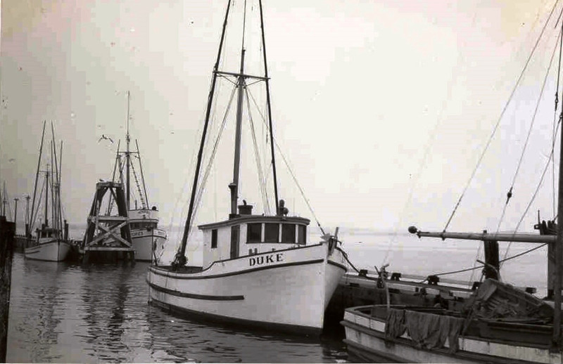 Duke at the dock in Samoa, California. 1950s