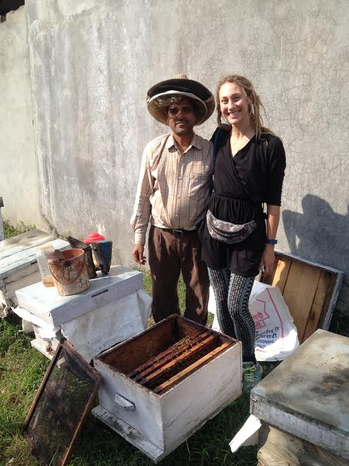 Ishwori and me checking on his royal jelly production in a cell building hive.