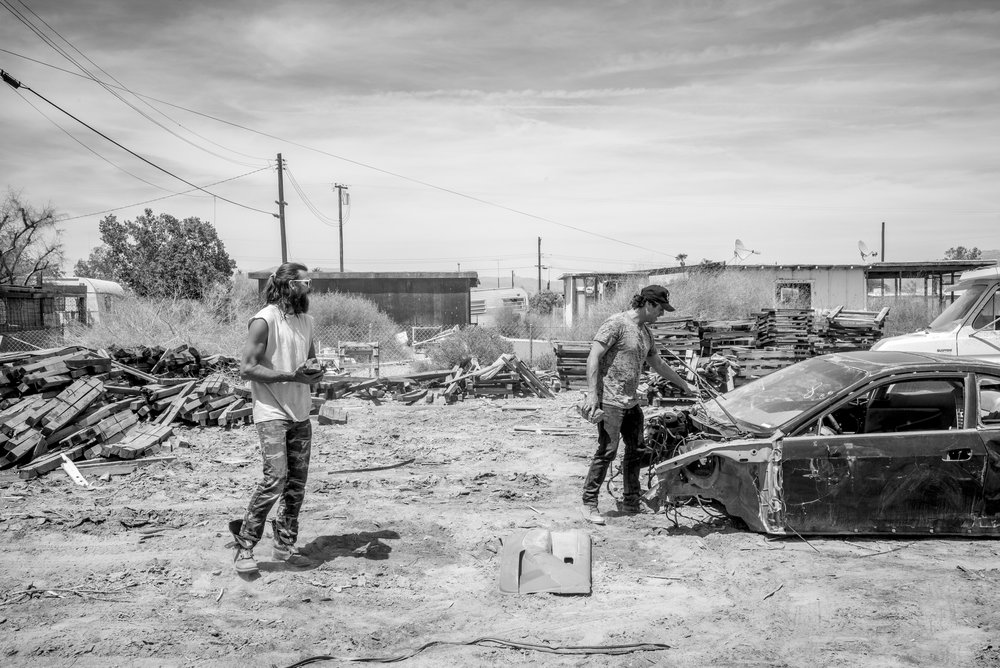 Sean Taylor and co Founder Stefan Ashkenazy smashing cars for the Bombay Beach Drive In_photo by Tao Ruspoli.jpg