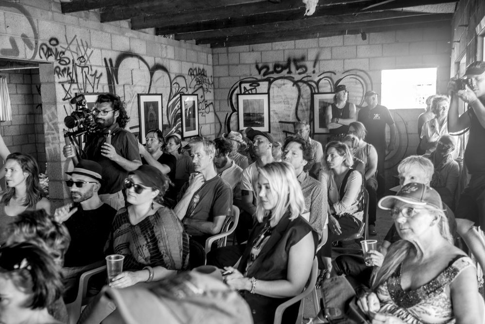 The crowd gathered to hear Professor Mark Wrathall and writer Geoff Dyer give a lecture at the Department of Redundancy Department at the Bombay Beach Biennale_photo Tao Ruspoli.jpg
