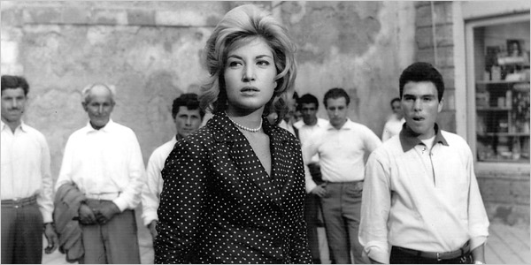 L'avventura Claudia surrounded by men in Noto.jpg