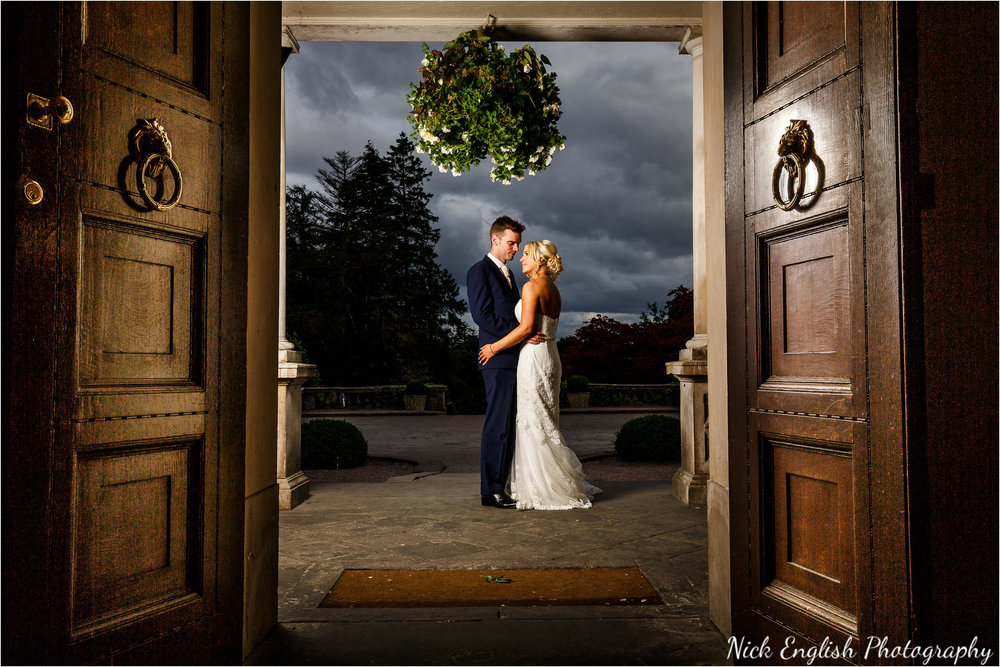 Bride and Groom in Eaves Hall Entrance doorway