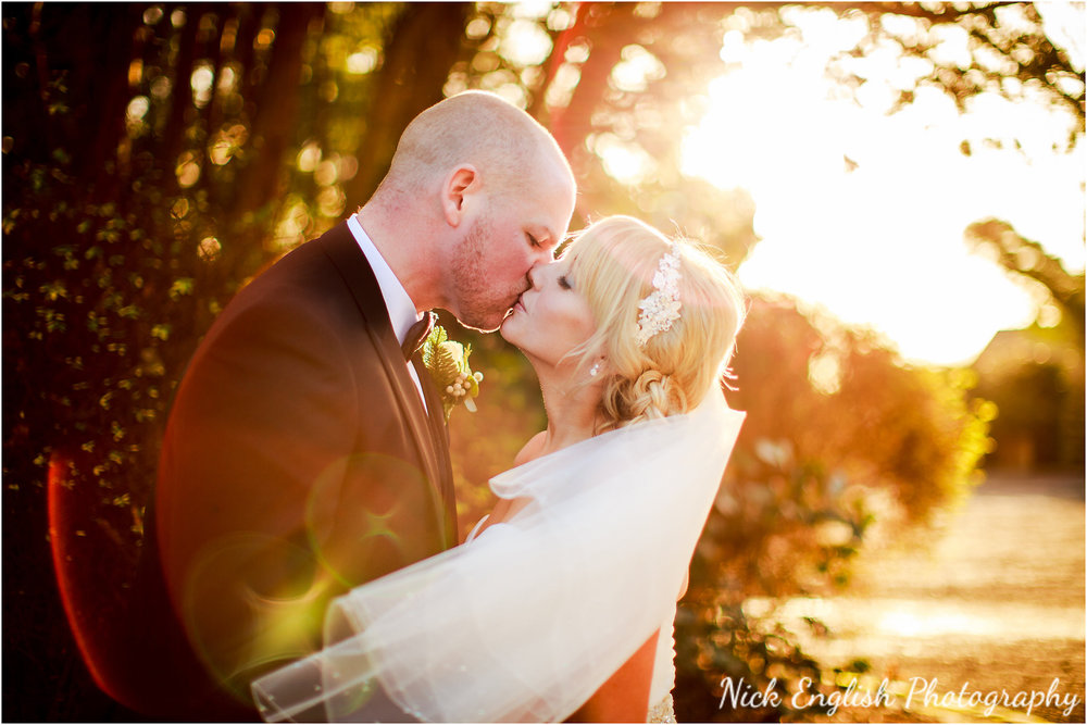 Mitton Hall Bride & Groom sunset kiss
