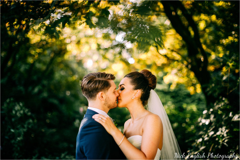 Eaves Hall Bride and Groom Kissing Colourful Summer September Wedding