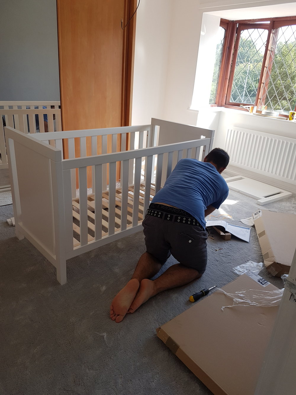 Daddy making my cot!