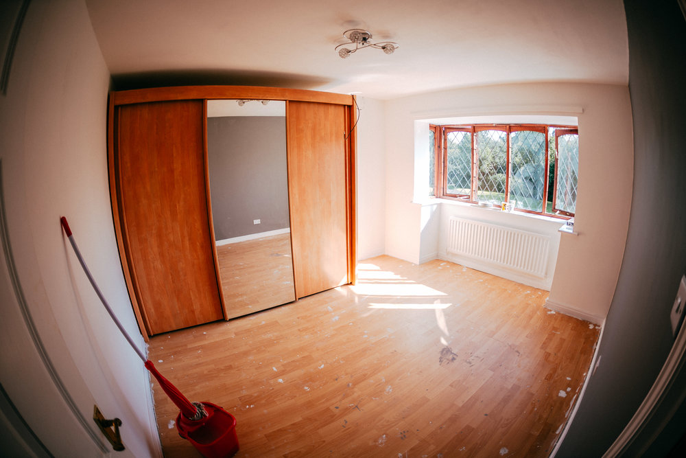Horrible laminate flooring covered in paint