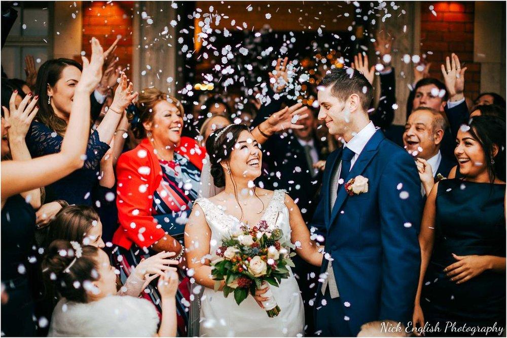 Eaves Hall Wedding Photograph - Confetti Bride & Groom