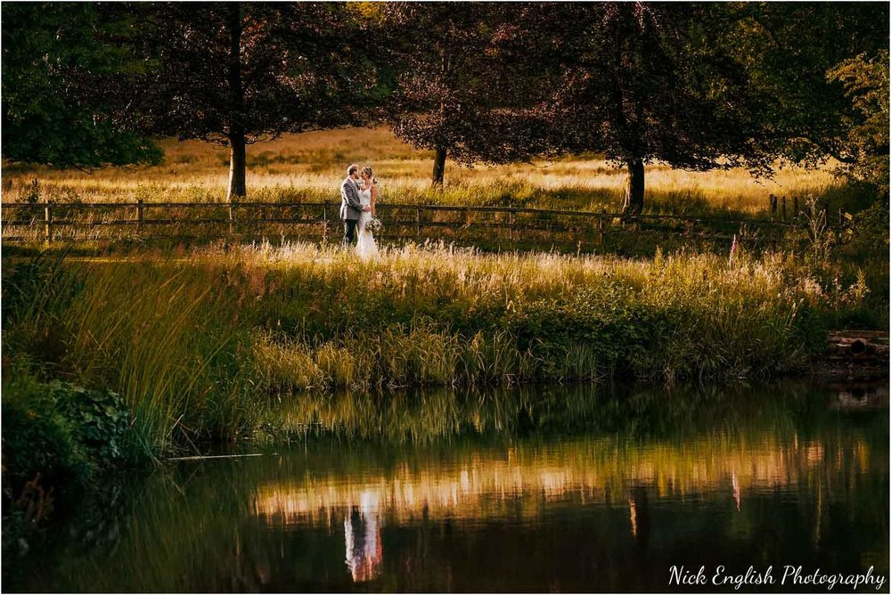 Browsholme hall lake photograph at sunset with bride and groom