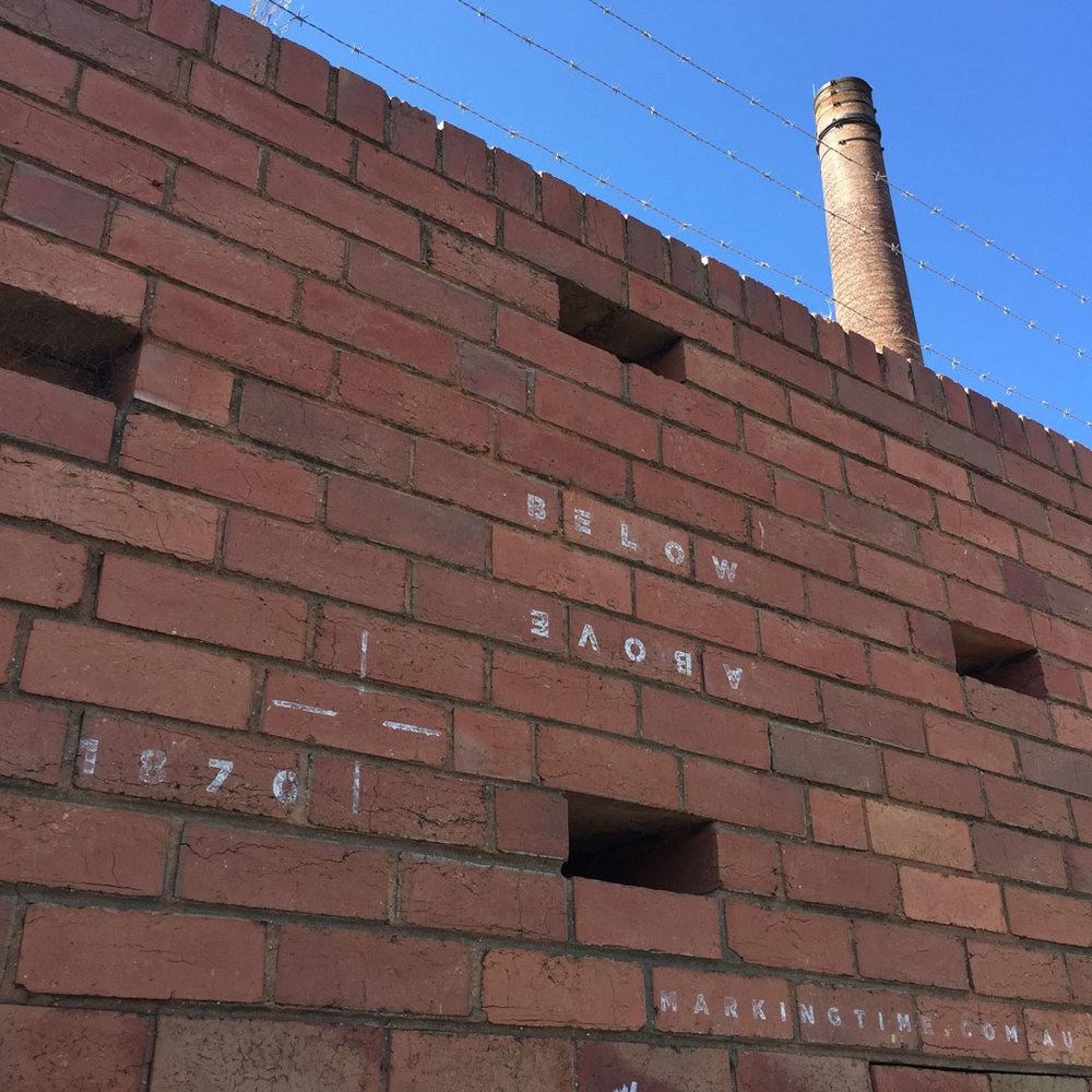 Below Above  (#2), Jessie Stanley, 4/11/2016. Ephemeral lime stencil, Hoffman's brickworks site, Brunswick.