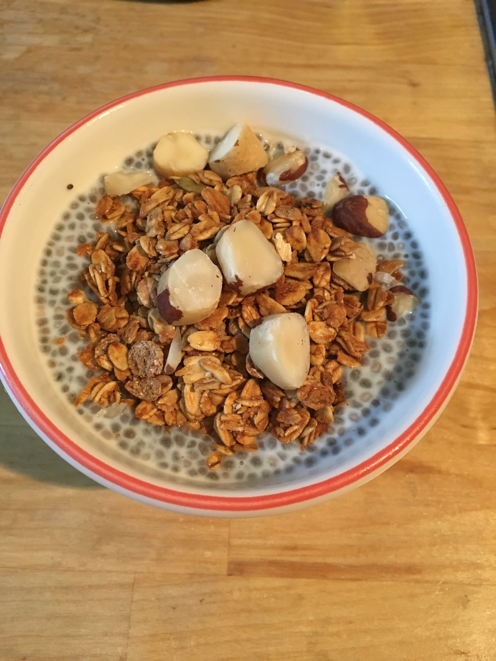 Overnight chia seed pudding with granola and brazil nuts to keep you feeling full til lunch!