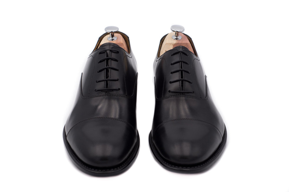 Optional : The Italian-made black tuscan calf leather cap toe oxfords with resoleable Goodyear welt and lasted shoe tree.
