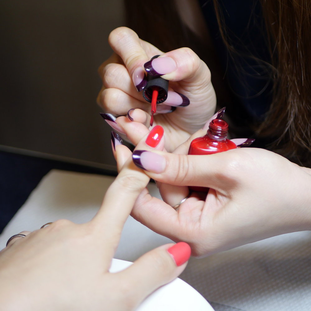 Demonstration of the application and removal of CND's Shellac nail polish (colour: Wildfire)