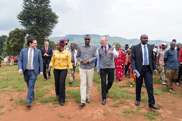 From left to right: Executive Director of the University of Global Health Equity Peter Drobac, Deputy Director of Inshuti Mu Buzima Antoinette Habinshuti, Minister of Education Musafiri Papias Malimba, PIH Co-founder Paul Farmer, and Director of Campus Development Emmanuel Kamanzi walk the grounds of the future campus. Photo by Aaron Levenson