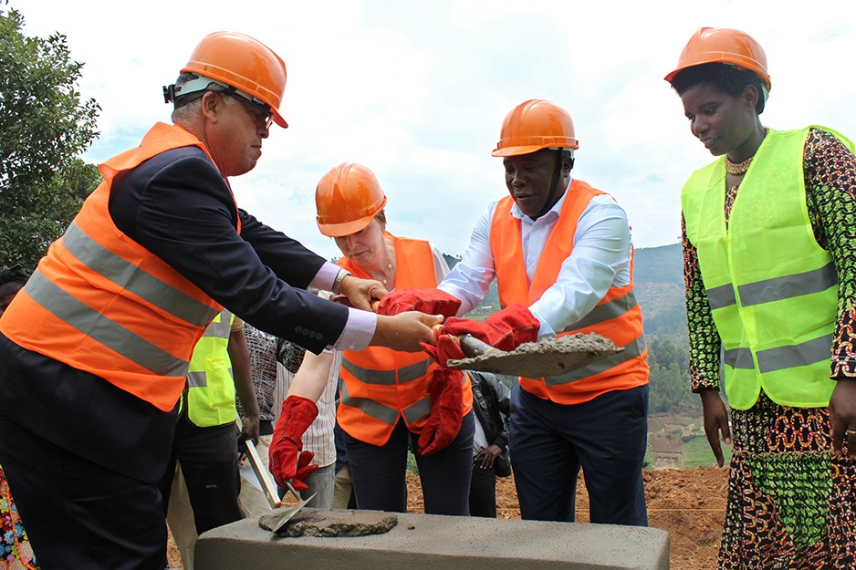 (Left to right) Dr. Alex Coutinho, executive director of Inshuti Mu Buzima; PIH co-founder Ophelia Dahl; Burera Mayor Florence Nambajemariya; and Northern Province Governor Jean Marie Vianney Gatabazi, lay the first bricks for construction of the Butaro Cancer Support Center in Rwanda, on Sept. 15, 2017. Photo by Bpb Muhumuza