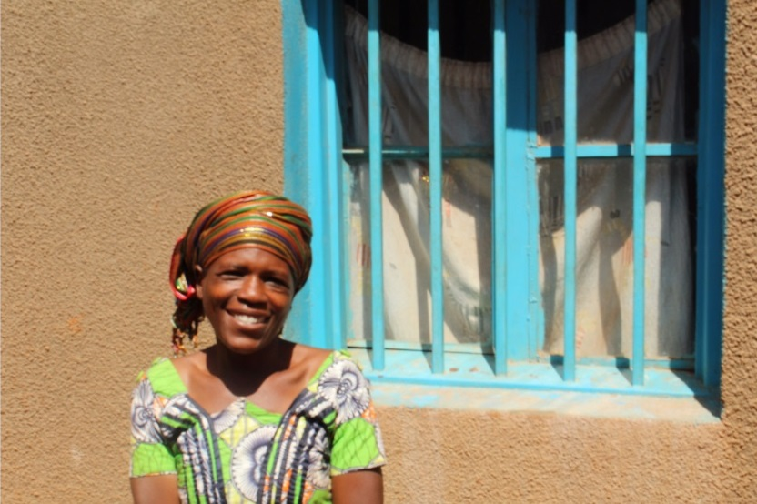 Constance Mukanana in front of her house. Photo by Alida K.Ruzibiza