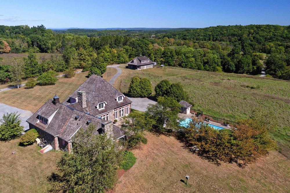 Diagnol aerial shot showing both homes & pool.jpg