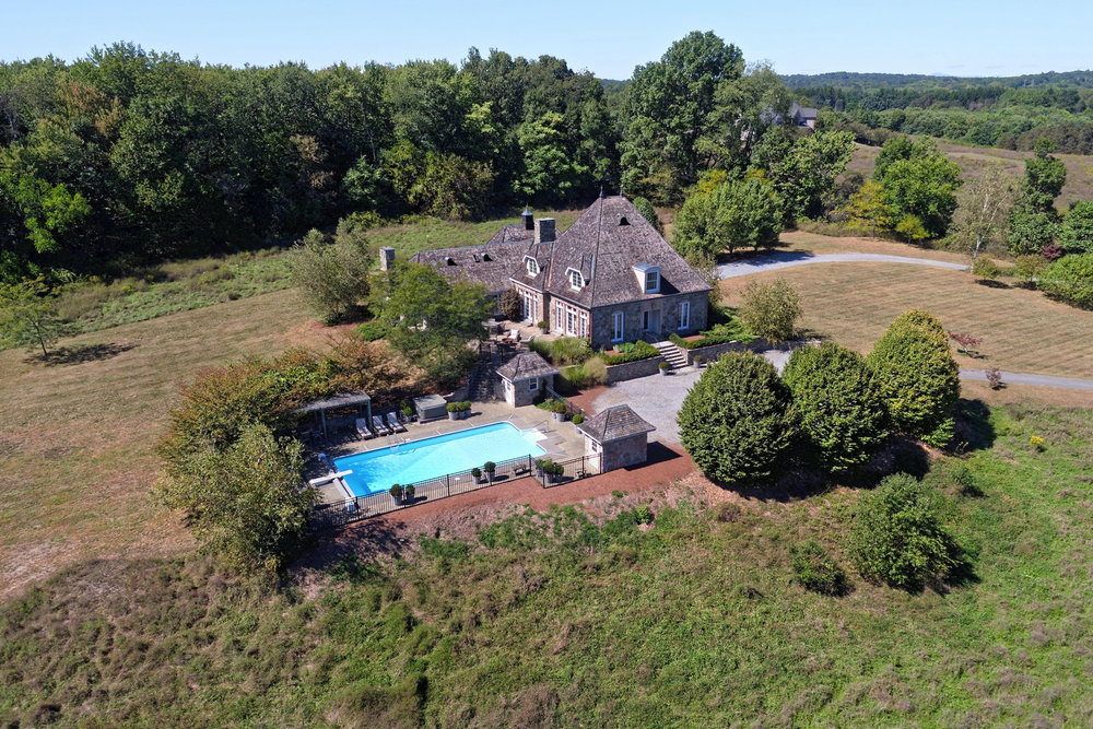 Aerial shot including pool and house.jpg