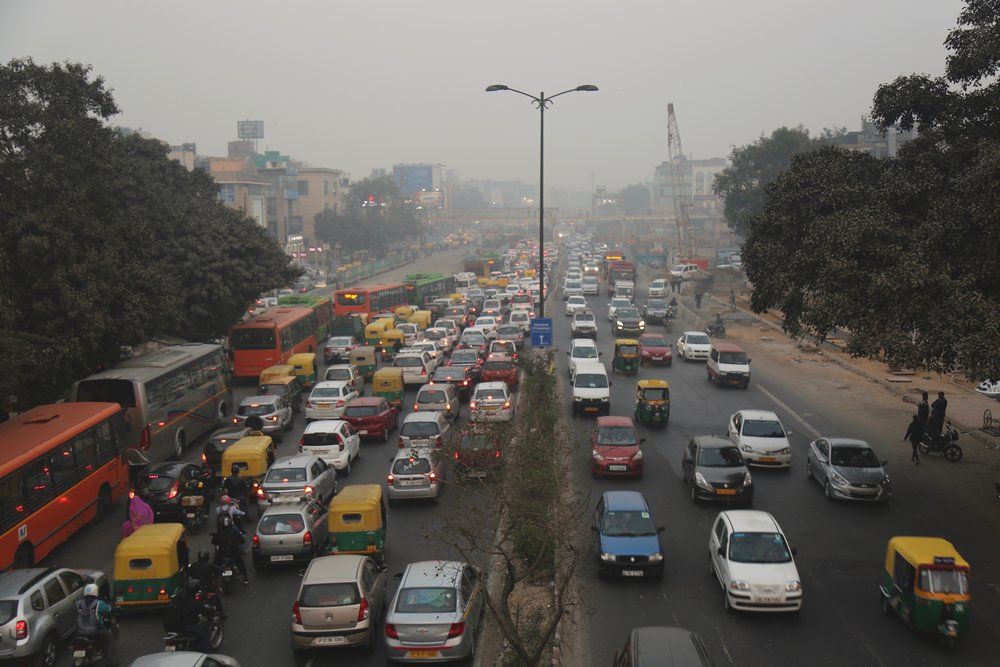 "There are around 10 million vehicles in Delhi, nearly 5 times as much as in London. Efforts have been made by the government to reduce the amount of vehicles on the road. ""It helped for a little bit,"" a tuk-tuk driver shrugs, ""but then people got round the legislation and now it is back to the same as before."" (Delhi)"
