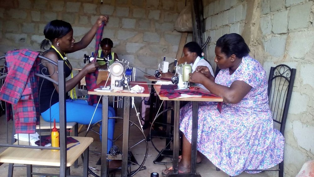 MAKING MOONCATCHER KITS  – Members of the Woman With a Purpose Sewing Guild in Wakiso Uganda, sew pad kits. The WWP is the first MCP sewing guild in Africa.