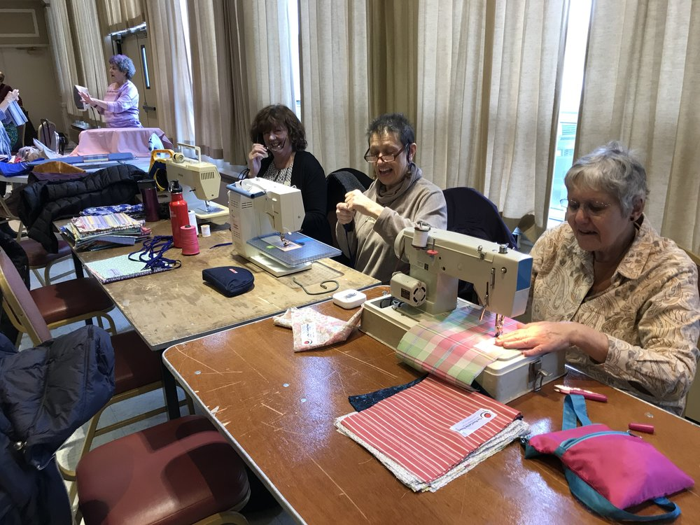 Our wonderful volunteers making MoonCatcher Kits at St. Sophia's Church in January.