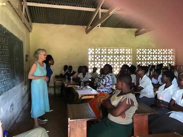Ellie and Olipa teaching our menstrual and reproductive health curriculum