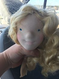 Then stitch the eyes and try on some hair... This was for sure a blonde.