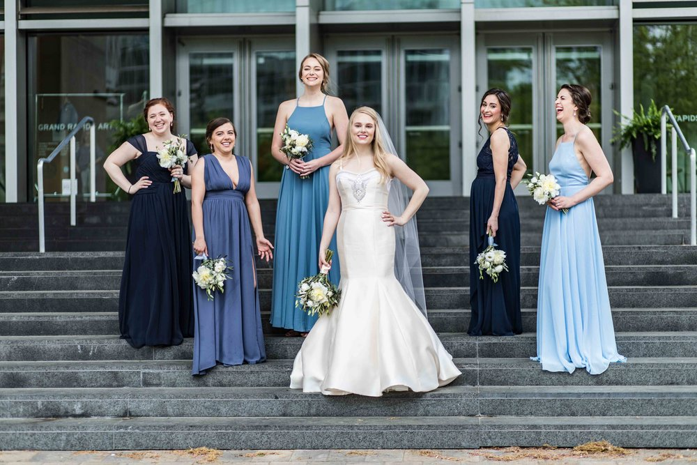 The bridesmaids posing on steps with the Bride
