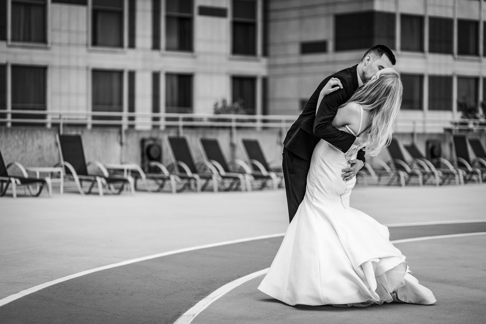 A rooftop kiss for the bride