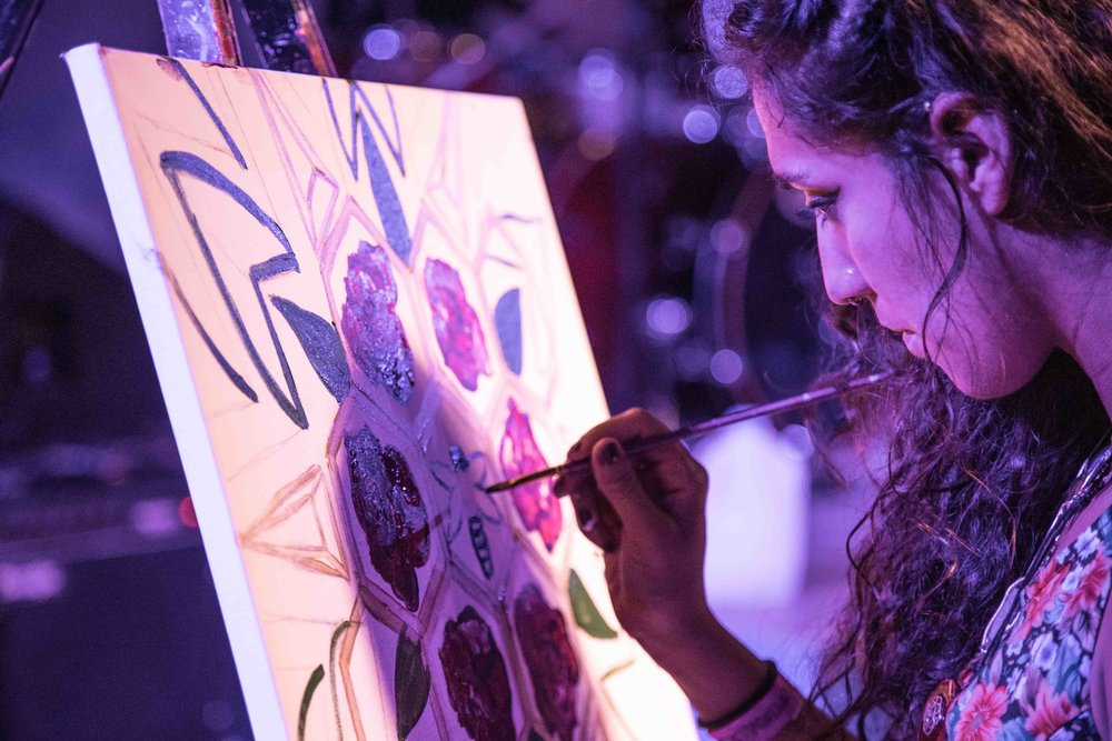 Local Artist paints to live music on stage at the Buttermilk Jamboree event