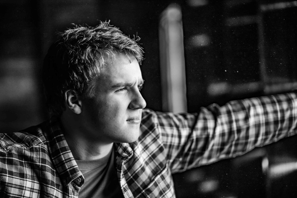 CDP Senior Photo Black and white looking out window.jpg