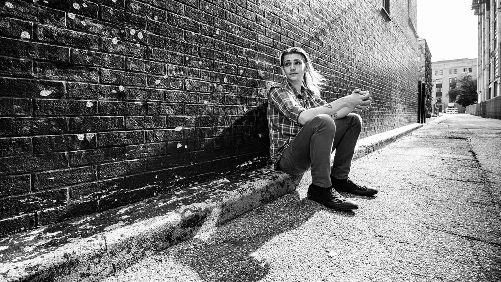 CDP Wide angle senior in alley with shadow.jpg