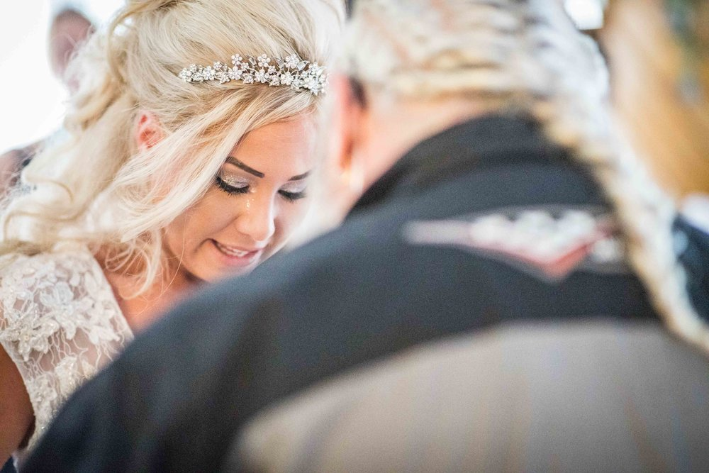 The bride cries as she sees her ill father