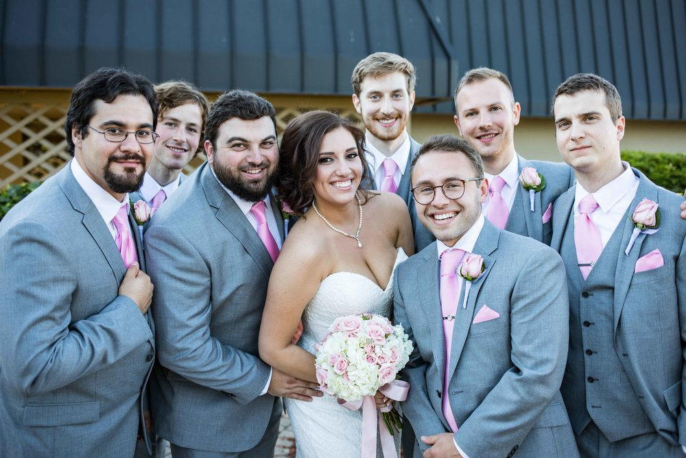 bride with all the groomsmen
