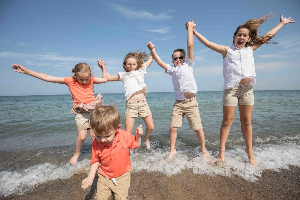 grand children jumping in lake michigan