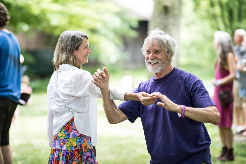 an older couple dancing together
